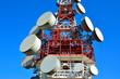 Leinwanddruck Bild - antenna tower transmissions in the blue sky