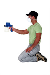 A painter using a spray gun.