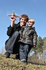 Father and son about to launch a toy plane