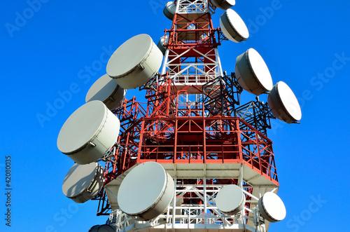 Leinwanddruck Bild antenna tower transmissions in the blue sky