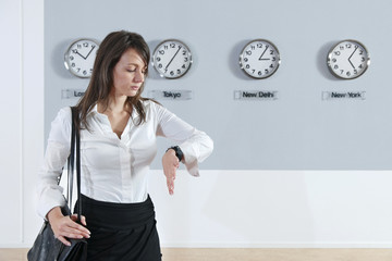 Businesswoman Checking Time