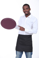 young black waiter showing his platter
