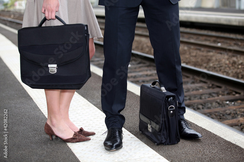 Businesspeople waiting at the trainstation