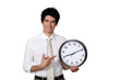 Happy businessman showing a clock