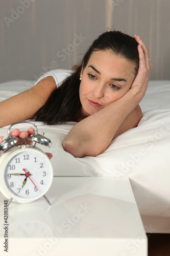 Woman stopping Alarm