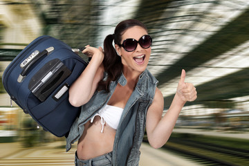 woman on the train station going on vacation