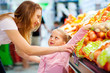 mother and daughter shopping for fruit and vegetable