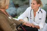 medical assistant taking care of senior woman