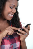 Smiling woman with a touch sensitive phone