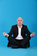 Businessman sitting in a lotus position