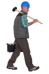 Construction worker carrying tools