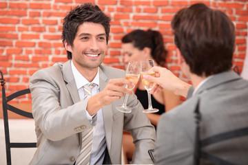 Friends having a celebratory drink