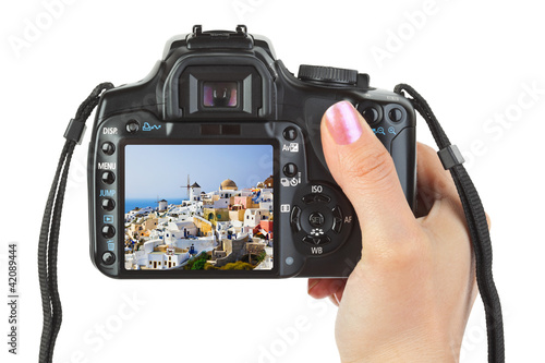 Camera in hand and Santorini (Greece) view