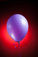 festive purple balloon on red background