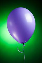 festive purple balloon on green
