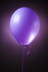 festive purple balloon on purple background