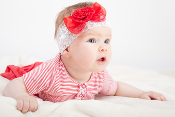 Cute baby girl with red bow