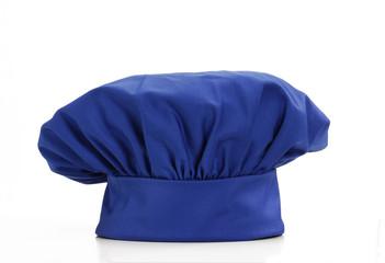 Sombrero de chef azul sobre fondo blanco.