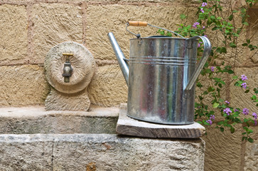 Watering can on washhouse.