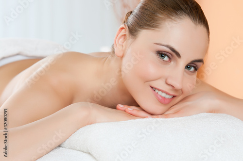 Happy woman at spa