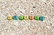 The word Welcome - written on wood cubes, at the beach