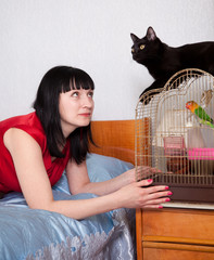 woman with   cat and parrot