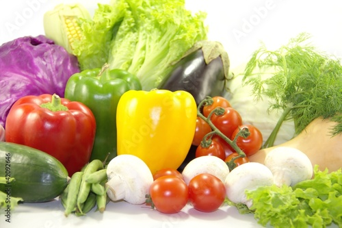 Bright healthy vegetables on white