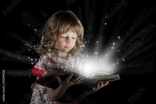 Teen girl reading the Book.