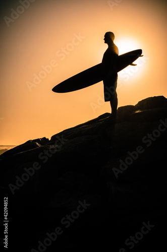 Surfer watching the waves
