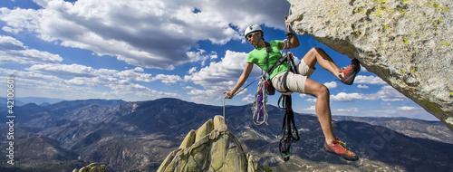 Climber rappels.