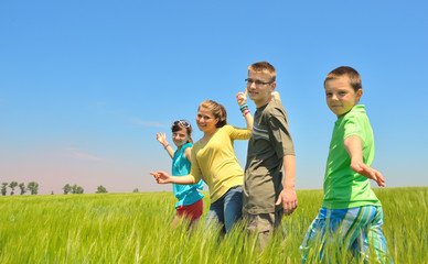kids play in wheat field