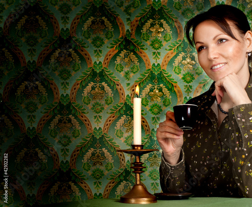 Caucasian woman with a cup sitting