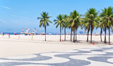 Fototapety View of Copacabana beach with palms and mosaic of sidewalk