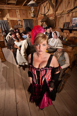 Bar Maid in Crowded Saloon