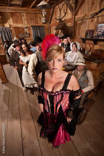 Bar Maid in Crowded Saloon