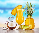 Fototapety Pina colada drink with blur beach on background