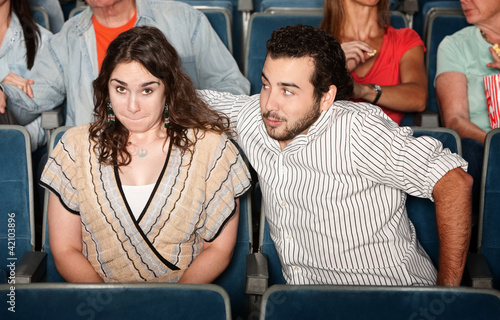 Guy Flirting in Theater