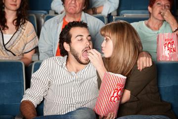 Woman Feeds Boyfriend at Movie