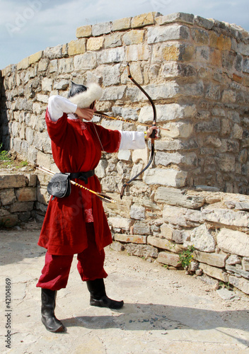 Medieval archer on castle wall