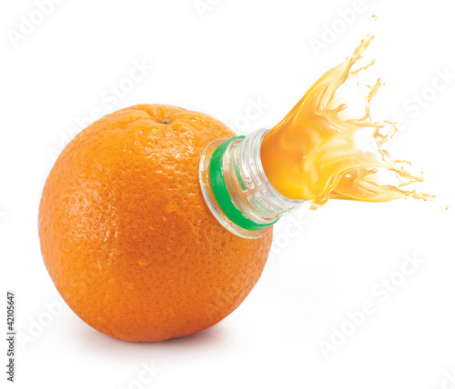 Orange with bottle neck and juice splashes on white