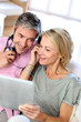 Couple listening to music at home with tablet