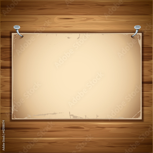 old paper sheet on the wooden background