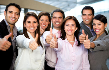 Business group with thumbs up
