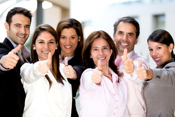 Business people with thumbs up