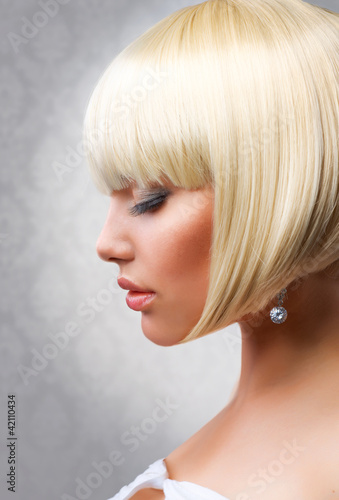 Haircut. Beautiful Girl with Healthy Short Blond Hair