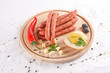 wooden chopping board with sausages,  cheese, bread and mustard