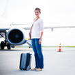 young woman at an airport having just left the aircraft