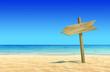 Leinwanddruck Bild - Empty wooden signpost on idyllic tropical sand beach