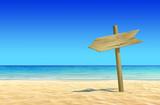 Fototapety Empty wooden signpost on idyllic tropical sand beach