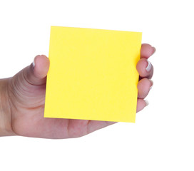 Female hand with a yellow post-it